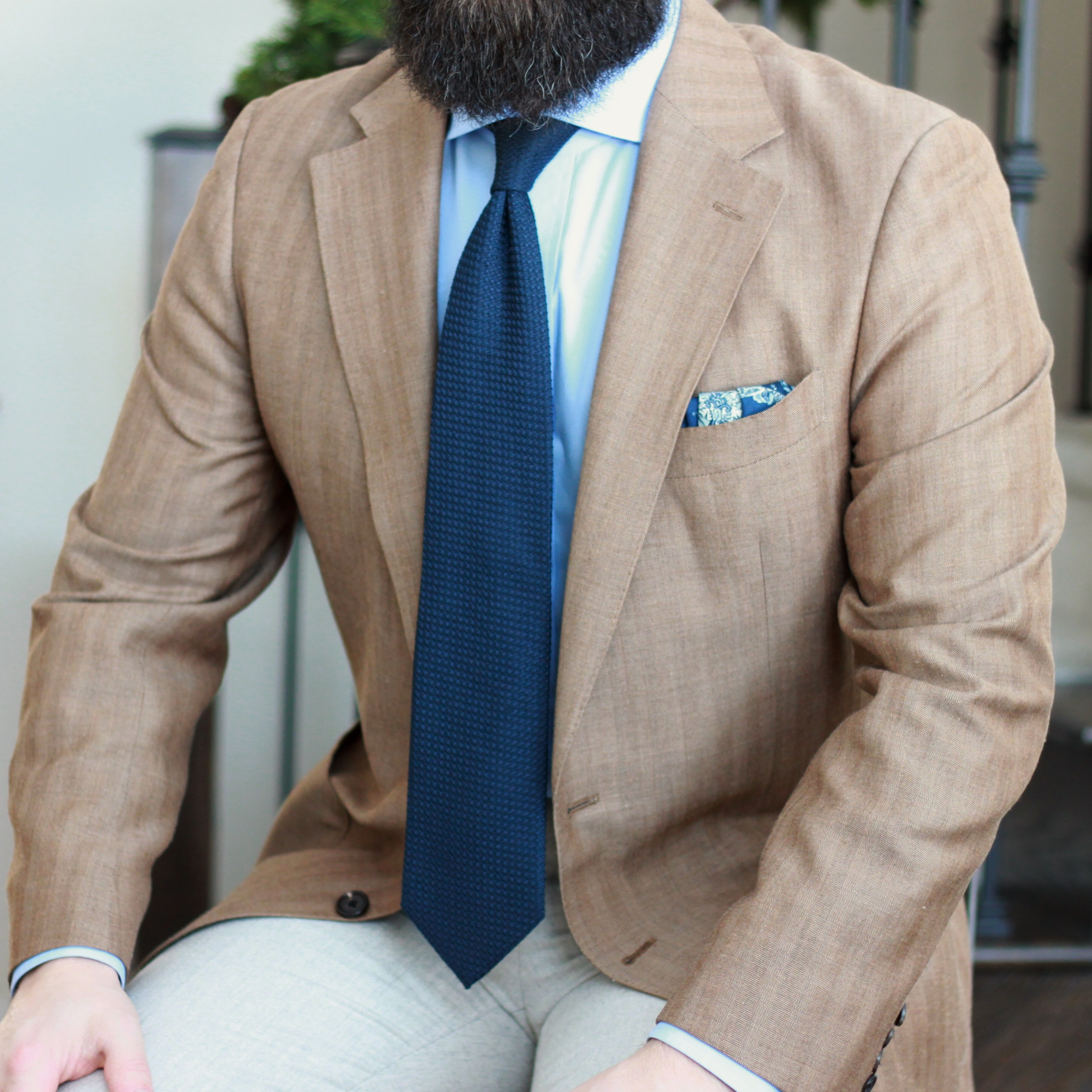 sport coat, grenadine tie, photography, seated, herringbone,